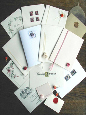 A selection of handmade wedding invitations and wedding stationery from the following exclusive collections: wax sealed wedding stationery, handmade ribboned designs, hand-tinted florals, illuminated letters and church illustrated stationery.